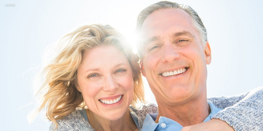 Mature Couple Smiling in the Sunlight