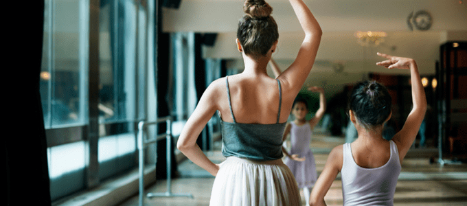 Two Young Woman Practicing Ballet